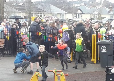 Children rush in to use their new play area
